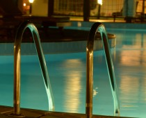 Outdoor Swimming pool with Ladder. Horizontal shot